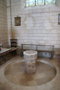 Baptismal font surrounded by its swimming pool